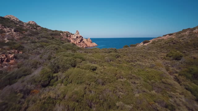 Aerial video of a paradisiac beach on the island of Mortorio in Sardinia, incredible island of the Emerald Coast in Italy video