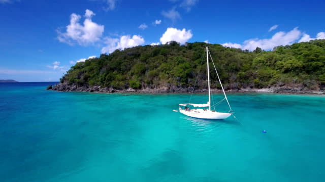 aerial video of a sailboat anchored in the Virgin Islands video