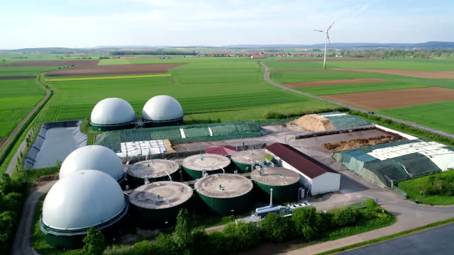 Aerial video of Biogas plant, alternative energy sources, renewable energy Camera flight over biogas plant from pig farm. Renewable energy from biomass. Modern agriculture European Union. aerial view, panoramic view from the air. biofuel stock videos & royalty-free footage