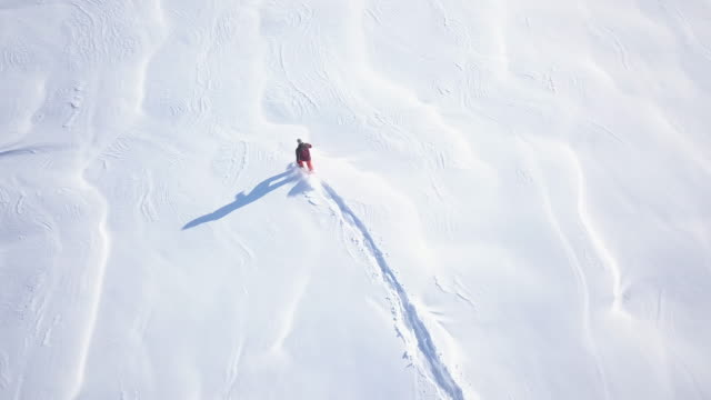 4K UHD Aerial Video of Man Snowshoeing in Fresh Powder Snow video