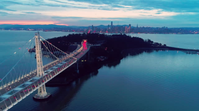 Aerial video of the Bay Bridge and San Francisco skyline Aerial video of the Bay Bridge and San Francisco skyline at dusk with moving traffic oakland stock videos & royalty-free footage
