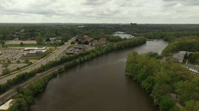 Aerial Video of the Huron River and a Dam on the Huron River in Ypsilanti, Michigan