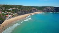 istock Aerial video shooting. Beautiful landscape of Arrifana beach, Aljezur, Portugal, Algarve. Ideal place for surfing, fishing. 1293924702