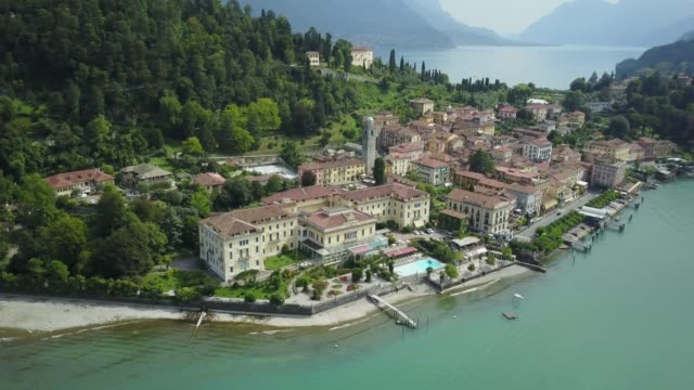 aerial video shooting with drone on bellagio - lombardia video stock e b–roll