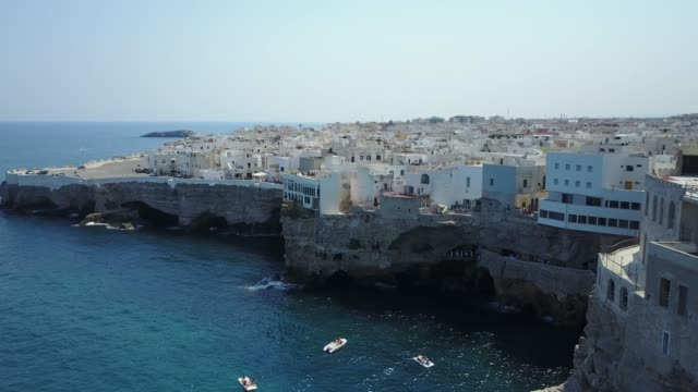 Aerial video shooting with drone on Polignano a Mare Aerial video shooting with drone on Polignano a Mare, famous Salento city on the Mediterranean sea ancient architecture stock videos & royalty-free footage