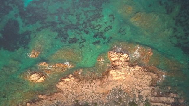 Aerial video shot by a drone of a turquoise sea in Italy. Beautiful beach of the Emerald coast in Sardinia. video