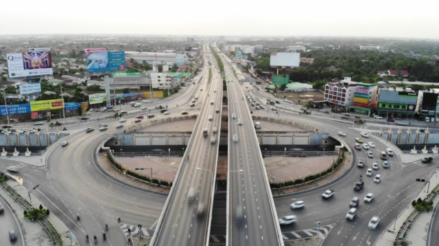Aerial view 4 way road stop circle or intersection traffic at evening for transportation concept