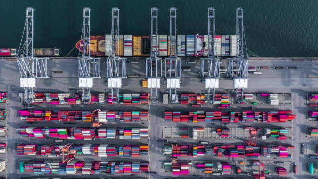Aerial view 4K Timelapse of  container cargo ship in import export business logistic and transportation of international by container cargo ship in the open sea.