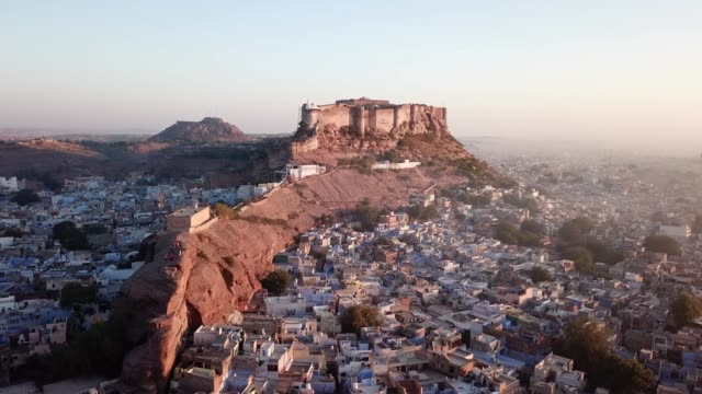 aerial view 4k video by drone of blue city and mehrangarh fort in jodhpur - india video stock e b–roll
