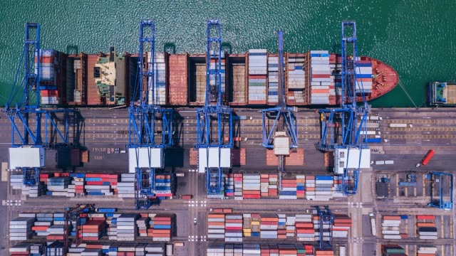 Aerial view, 4K.Time lapse Industrial port with Container port where is a part of shipping Aerial view, 4K.Time lapse Industrial port with Container port where is a part of shipping commercial dock stock videos & royalty-free footage