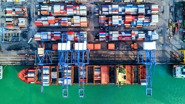 aerial view, 4k.time lapse industrial port with container port where is a part of shipping - warehouse aerial stock videos & royalty-free footage