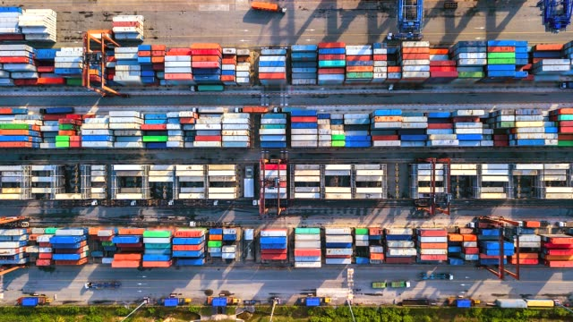 vídeos de stock e filmes b-roll de aerial view, 4k.time lapse industrial port with container port where is a part of shipping - docas