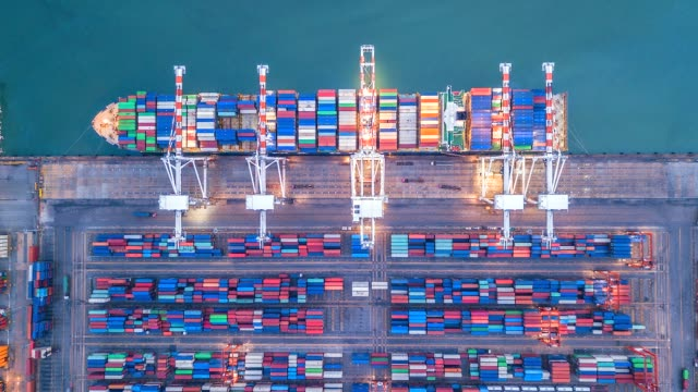 aerial view, 4k.time lapse industrial port with container port where is a part of shipping - nave mercantile video stock e b–roll