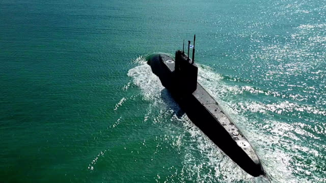 Bидео Aerial View - a modern missile submarine in the open sea