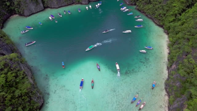 Aerial view a paradise with speed boat and perfect crystal clear video