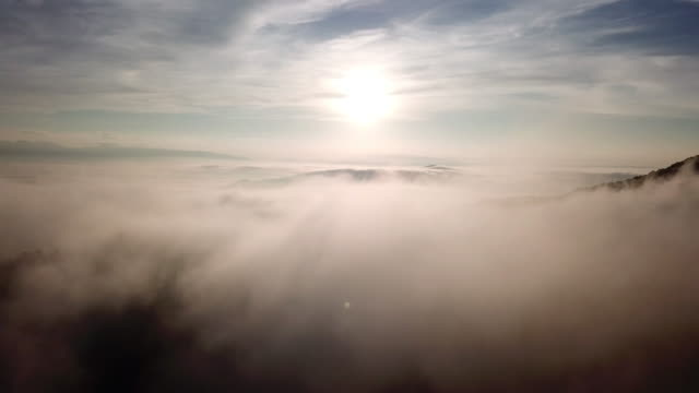 Aerial view above the clouds and sky in sunrise time , Inspiration concept Aerial view above the clouds and sky in sunrise time , Inspiration concept 4K(UHD) atmosphere stock videos & royalty-free footage