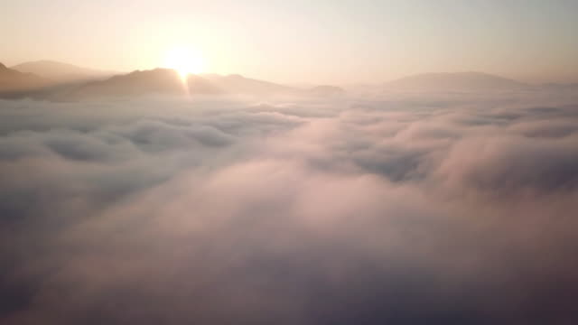 aerial view above the clouds and sky in sunrise time , inspiration concept - clouds stock videos & royalty-free footage