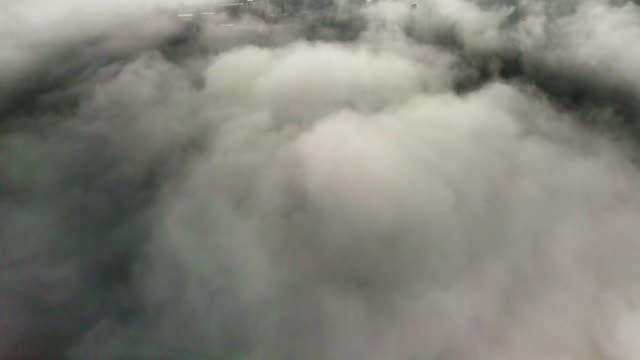 flygvy ovanför molnen och himlen - earth from space bildbanksvideor och videomaterial från bakom kulisserna