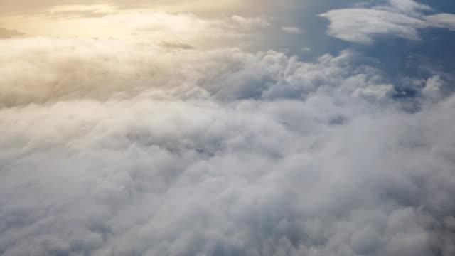 aerial view above the clouds - passare davanti video stock e b–roll