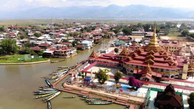 aerial view alodaw pauk pagoda in inle lake, myanmar - burma home do стоковые видео и кадры b-roll