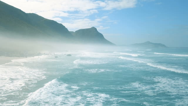 Aerial view along a misty coastline Drone shot of misty coastline cape town stock videos & royalty-free footage