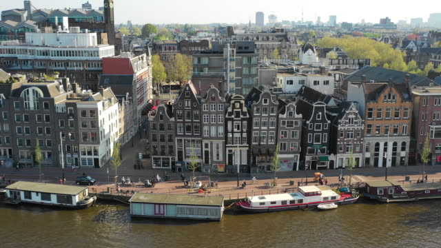 aerial view along the traditional old buildings in amsterdam - amsterdam video stock e b–roll