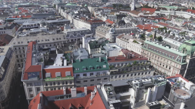 Aerial view and tilt from view-point to see building roof, gothic and baroque style, and cityscape of capital cities,  Vienna, on a sunny day with a clear sky, Austria. Concept of travel on vacation at an international landmark.