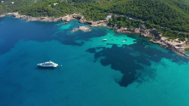 vídeos de stock e filmes b-roll de aerial view around scenic balearic islands. ibiza - ibiza