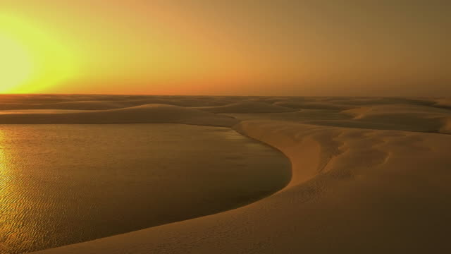 Aerial view at sunset of the Lencois Maranhenses. Aerial view at sunset of the Lencois Maranhenses, Brazil. desert oasis stock videos & royalty-free footage