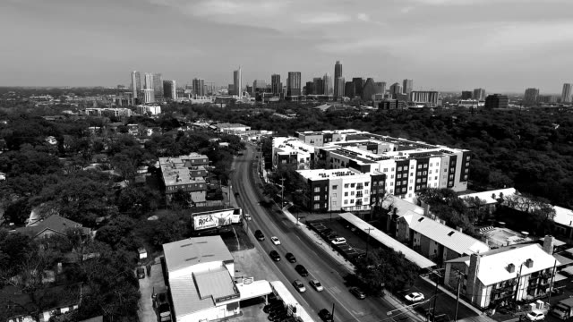 Aerial View Austin Texas 2016 Intersection and Condominiums on South Lamar Blvd with Skyline Cityscape Background black and white video