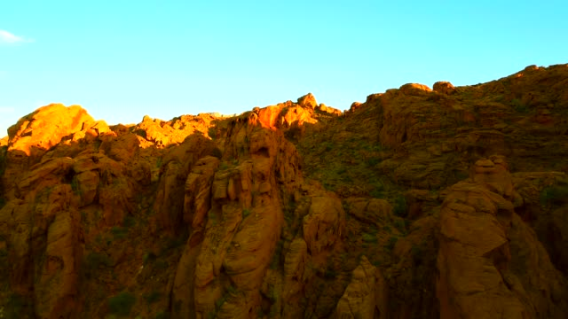 aerial view backwards through red rock canyons at sunset - red rock video stock e b–roll