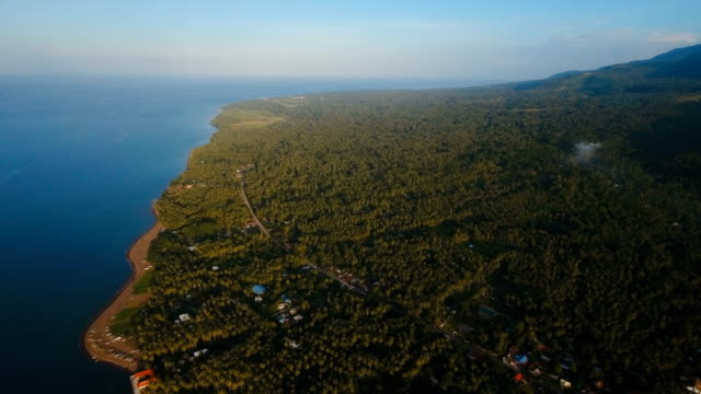 Aerial view beautiful coastline on the tropical island with volcanic sand beach. Camiguin island Philippines video