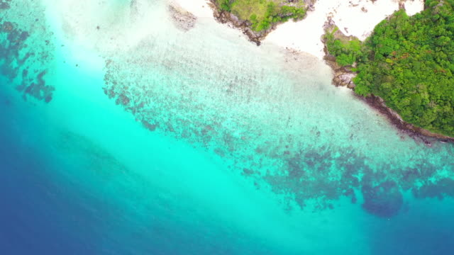 Aerial view beautiful tropical white sand beach and snorkel point at Cockburn Island, Andaman sea, Ranong, Myanmar.