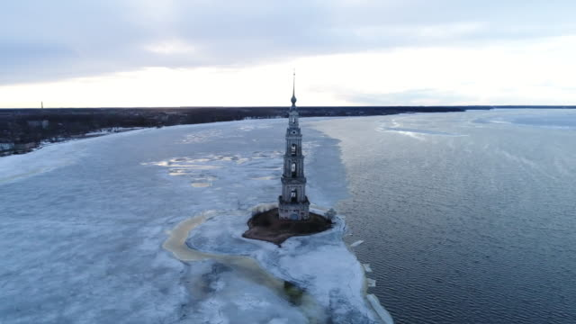 Aerial view Bell tower between water and ice video