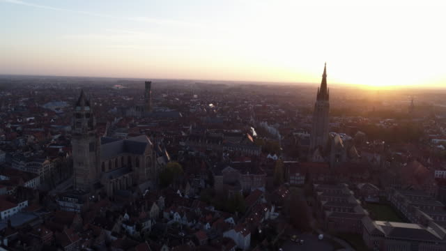 aerial view bruges at sunrise - bruges video stock e b–roll