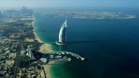 Aerial view Burj Al Arab, Jumeirah Beach Hotel Dubai Dubai - November 18: Aerial view Dubai coastline, Burj Al Arab, Jumeirah Beach Hotel Dubai November 18, 2012 RED EPIC middle east stock videos & royalty-free footage