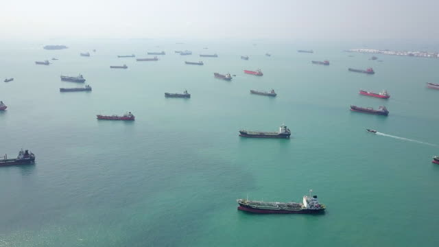 aerial view cargo ship and tanker in the sea. singapore - nave mercantile video stock e b–roll