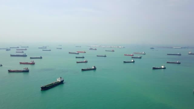 aerial view cargo ship and tanker in the sea. singapore - nave cisterna video stock e b–roll