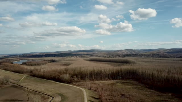 Bидео Aerial view Clouds over over countryside. Spring Countryside.