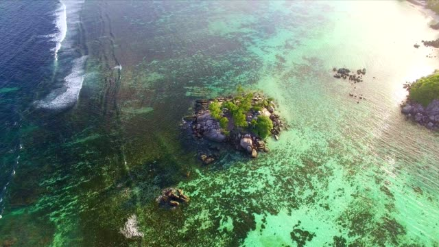 Aerial view: coastline of Mahé Island, Seychelles at sunset video