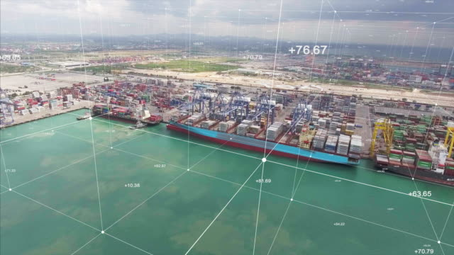 aerial view, crane and container ship in cargo port with futuristic network connections - nave mercantile video stock e b–roll