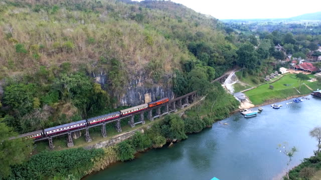 aerial view death railway bridge over the kwai noi river at krasae cave in kanchanaburi province - burma home do стоковые видео и кадры b-roll