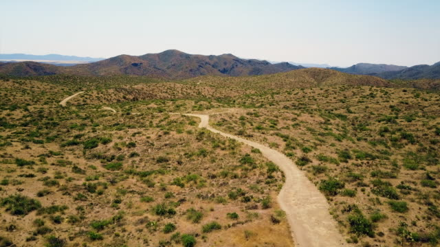 Aerial view dirt road at desert 4K video