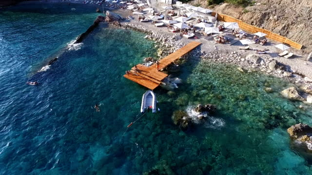 Aerial view dock with an inflatable boat near the beach video