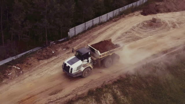 Aerial view driving dump truck aerial view on building site in nature dump truck stock videos & royalty-free footage