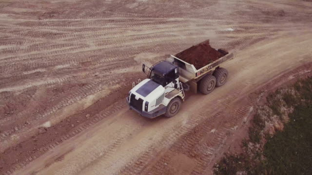 Aerial view driving dump truck video