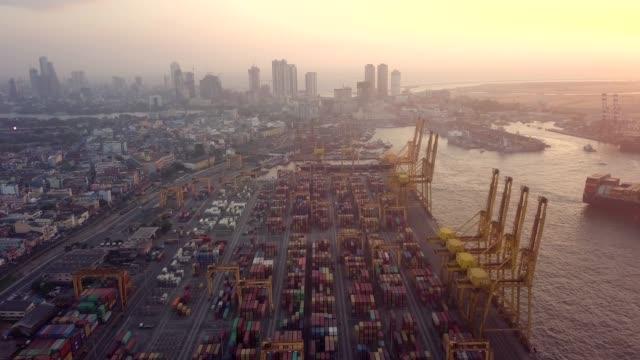 vídeos de stock e filmes b-roll de aerial view drone 4k footage of container cranes in port, colombo. - sri lanka