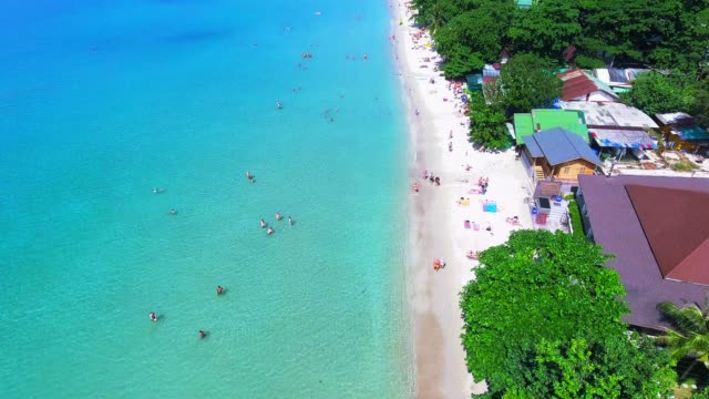 Aerial view drone footage of the coastline and tourist Koh Chang Beach Top View. Aerial view; drone footage of the coastline and tourist of the Koh Chang Beach, Koh Chang island, Thailand. 4K Resolution. hovering stock videos & royalty-free footage