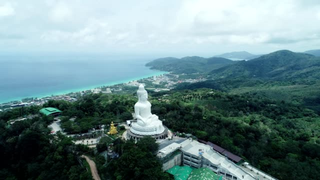 Aerial View drone shot of Big Buddha Statue on the high mountain at Phuket thailand