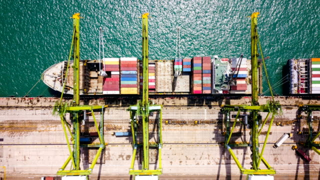 Aerial View drone-lapse or time-lapse of Industrial port with containers ship in Singapore Aerial View of Industrial port with containers ship industrial ship stock videos & royalty-free footage